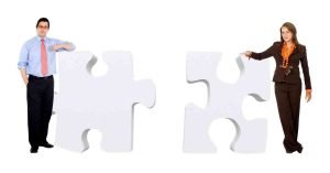 two people with puzzle pieces